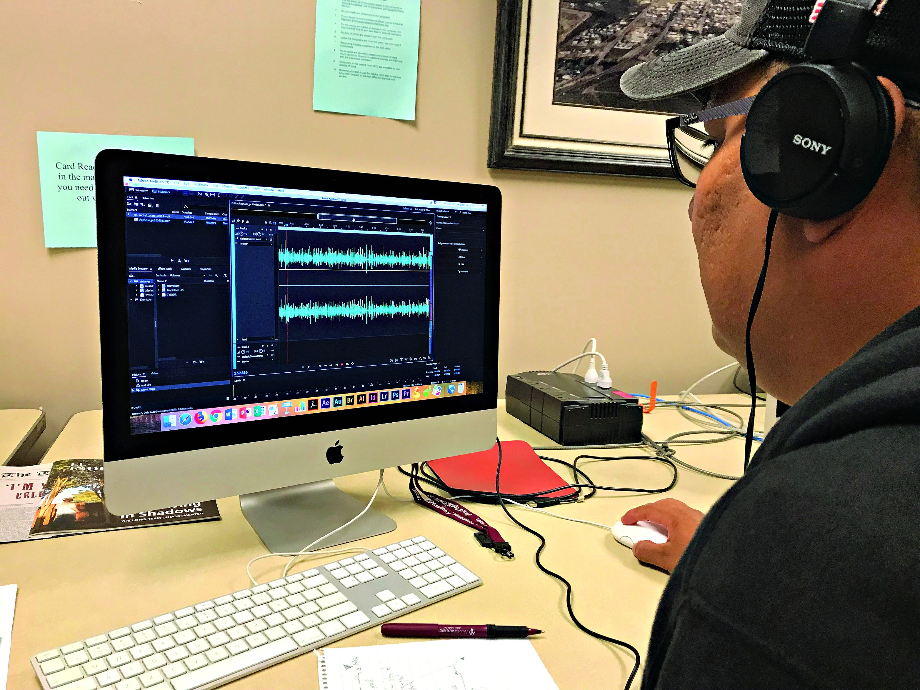 Student checks audio for a podcast.
