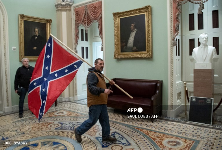 Man carrying confederate flag
