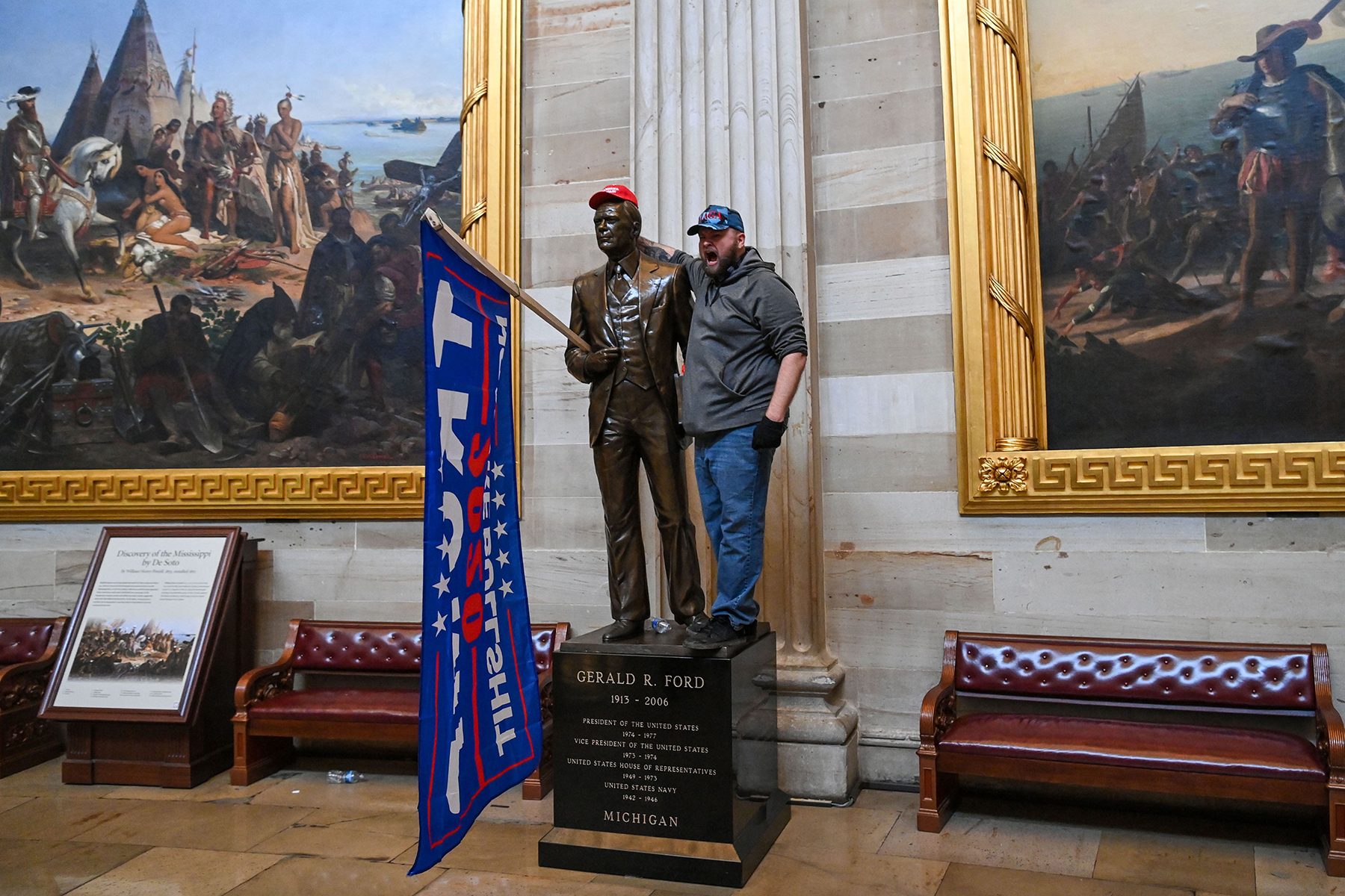 Man stands next to Gerald Ford statue