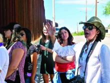 Prof. Celeste González de Bustamante speaks to students at the Mexican border.