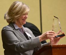 Dana Priest accepts the school's 2016 Zenger Award