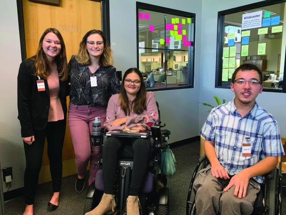 Group of students standing and in wheelchairs