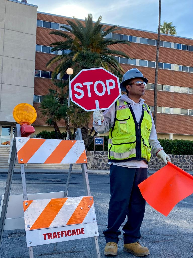 Construction worker directs traffic.