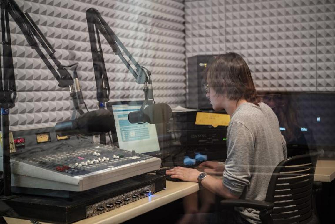 Student in radio recording booth