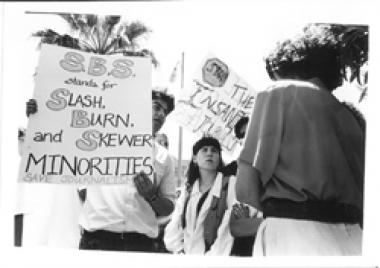Students protest the proposed elimination of the journalism program, 1994-96.